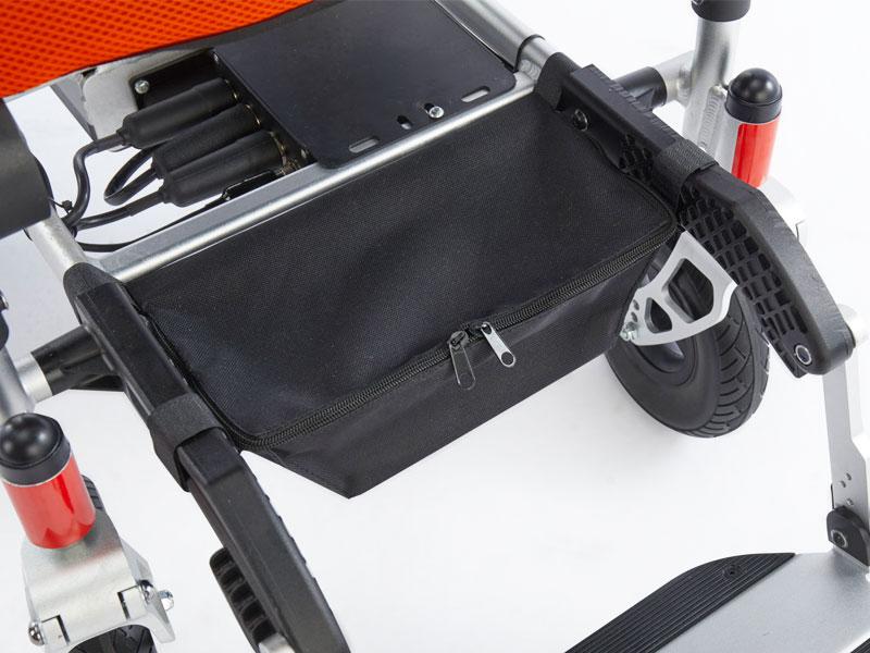 Opbergtas onder de zitting voor uw lader, joystick of persoonlijke spulletjes